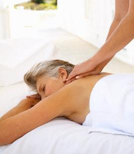 Middle-Aged Woman Receiving Massage --- Image by ? Mina Chapman/Corbis